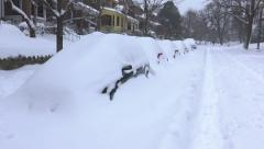 Snowed covered cars, residential street Stock Footage