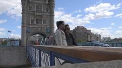 Romantic tourist couple take photo Tower Bridge London landmark traffic car  Stock Footage