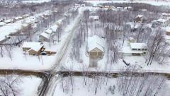 Small town neighborhood under deep blizzard snow - stock footage