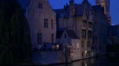 Dijver with old buildings and the Belfry of Bruges seen at night Stock Footage