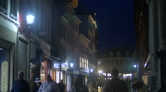 The Belfry of Bruges seen at night from Breidelstraat Stock Footage