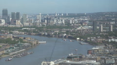 Stock Video Footage of Panoramic view Canary Wharf financial district London cityscape boat sail day