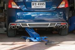 Checking car suspension Stock Photos