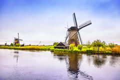 Windmills and canal in Kinderdijk, Holland or Netherlands. Unesco site Stock Photos