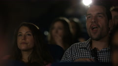 4K Man laughing loudly in cinema audience making his girlfriend embarrassed Stock Footage