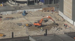 Aerial view excavator machine work construction site central London worker UK Stock Footage