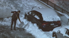 Man digs his parked car out of the snow. Stock Footage
