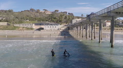 San Diego, Divers Walking Out of Water Stock Footage