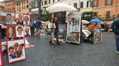 gimbal shot walking past artists in the piazza navona, rome - stock footage