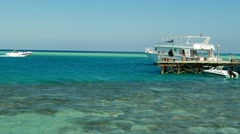 Sea vacation, tourism. Pier with ship and boats in the Red Sea, Egypt Stock Footage