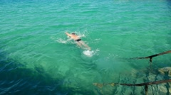 Tourist male vacationer swims and dives in Red Sea, Egypt  - stock footage