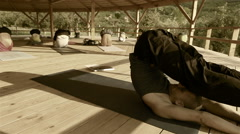 Toned footage of a yoga trainer conducting seminar Stock Footage