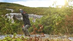 High-mountain training base camp: yoga trainer performs exercises having retired Stock Footage