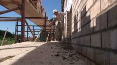 Brick Mason Working On New Home Construction Stock Footage