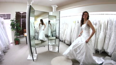 Beautiful bride stepping onto podium to view wedding dress - stock footage