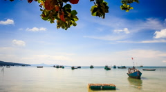 Vietnamese Boats Rock in Shallow Bay against Boats on Horizon - stock footage