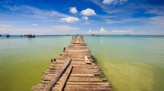 Old Wooden Pier Stretching to Azure Sea Boats at Horizon Closeup Stock Footage