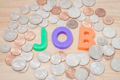 Job alphabet with various US coins - stock photo