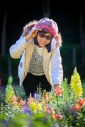 Portrait of happiness asian woman with smiling face in blooming flowers garde Stock Photos