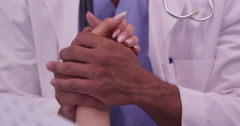 Doctor giving comfort to patient before surgery Stock Footage