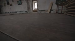 Wall With Peeling Paint and Old Wooden Floor Stock Footage