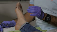 Pedicure removing plaster from injured toenail after pulled toe nail, close up. Stock Footage