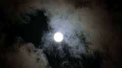 Time Lapse of Full Moon in the Night Sky with Clouds Passing Through Arkistovideo