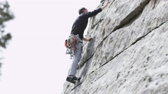 Man rock climbing with a lot of gear Stock Footage