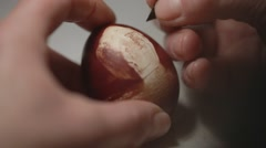 People decorate egg pattern scratching his Stock Footage