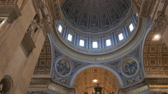 tilt down shot of the cupola and canopy inside saint peter's basilica, rome - stock footage