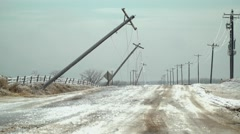 Many power poles and wires down in ice storm Stock Footage