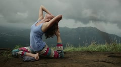 Sexy yoga girl doing yoga on top of indian mountain Stock Footage