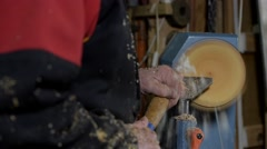 Woodturners using a rotating clamp to turn the wood. - stock footage