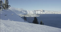 Tracking Red Camera Through Winter Crater Lake Landscape, Red Dragon Camera Stock Footage