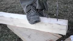 Worker drilling holes with electrical drill in a piece of wood Stock Footage