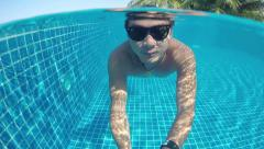 Underwater swimming. Man swims in the pool. Stock Footage
