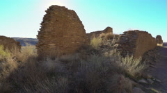 Tracking Shot of Native American Ruin & Sun Flare -Pan Left- Stock Footage