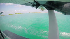 Water Plane taking off over the Maldivess. Stock Footage