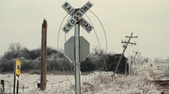 Powerlines on Rail Road Crossing during ice storm Stock Footage