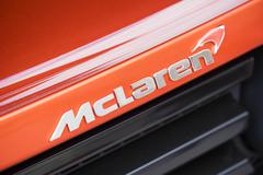 Stock Photo of Close-up view of the logo on a McLaren supercar