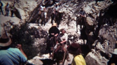 1972: Horse riding group coming down steep single dry track trail. Stock Footage