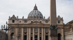 close up of the obelisk and saint peter's basilica, rome - stock footage