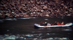 1972: Whitewater rafting guided tour down fast moving mountain river. Stock Footage