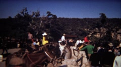 1972: Horseback riding meetup basecamp outdoor stables. Stock Footage