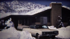 1972: 70's Dodge car parked in snowy mountain house driveway. Stock Footage