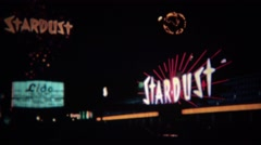 1972: Stardust hotel casino colorful neon sign shining bright at night. Stock Footage
