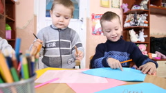 Children paint with crayons Stock Footage