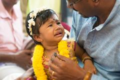 Traditional Indian Hindus ear piercing ceremony. - stock photo