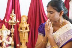Indian woman praying Stock Photos