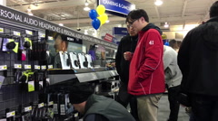 Best buy's black friday sale with shopper finding audio headphones to buy - stock footage